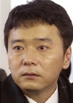Тосинори Оми